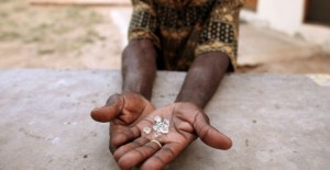 200462-an-illegal-diamond-dealer-from-zimbabwe-displays-diamonds-for-sale-in--687x357